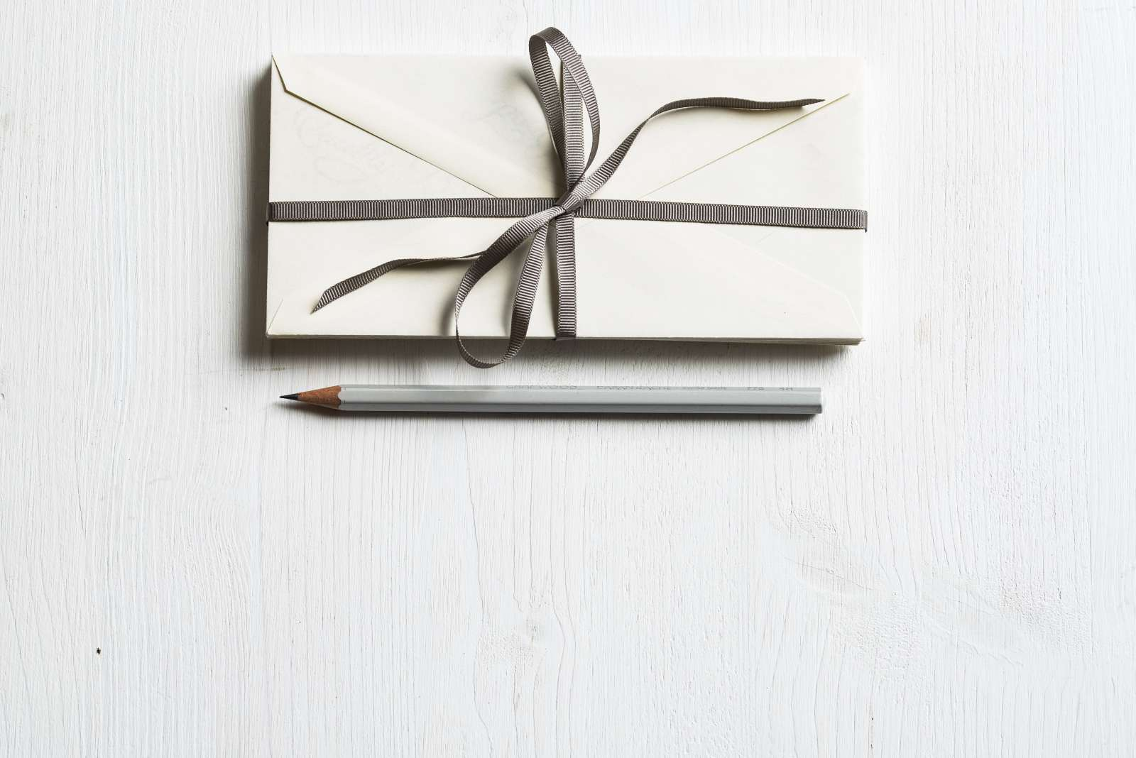 A pencil and letter