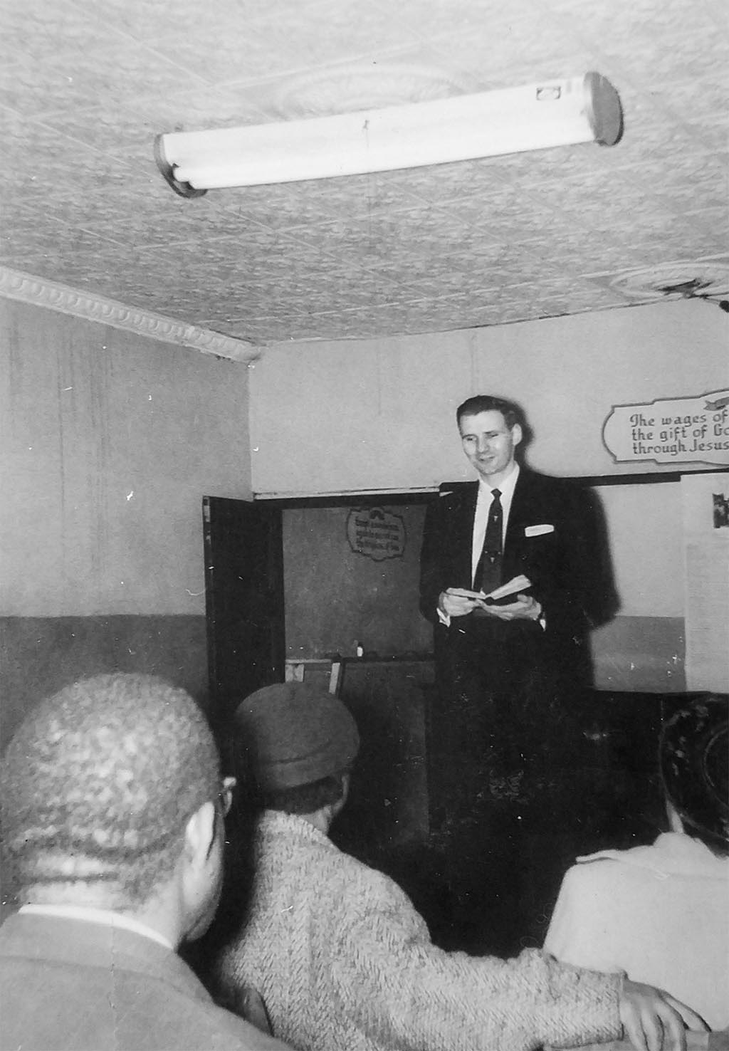 Raleigh Holt preaching to a group of men
