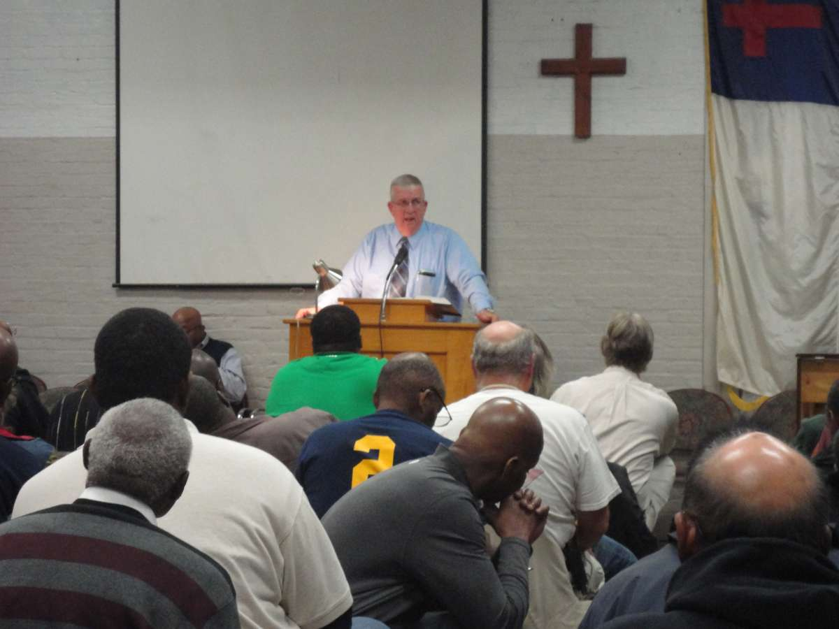 Pastor Charles Buettner addresses a group of men