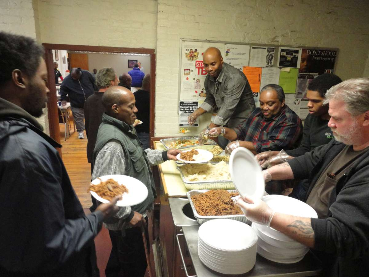 Men receiving meals from the mission's kitchen