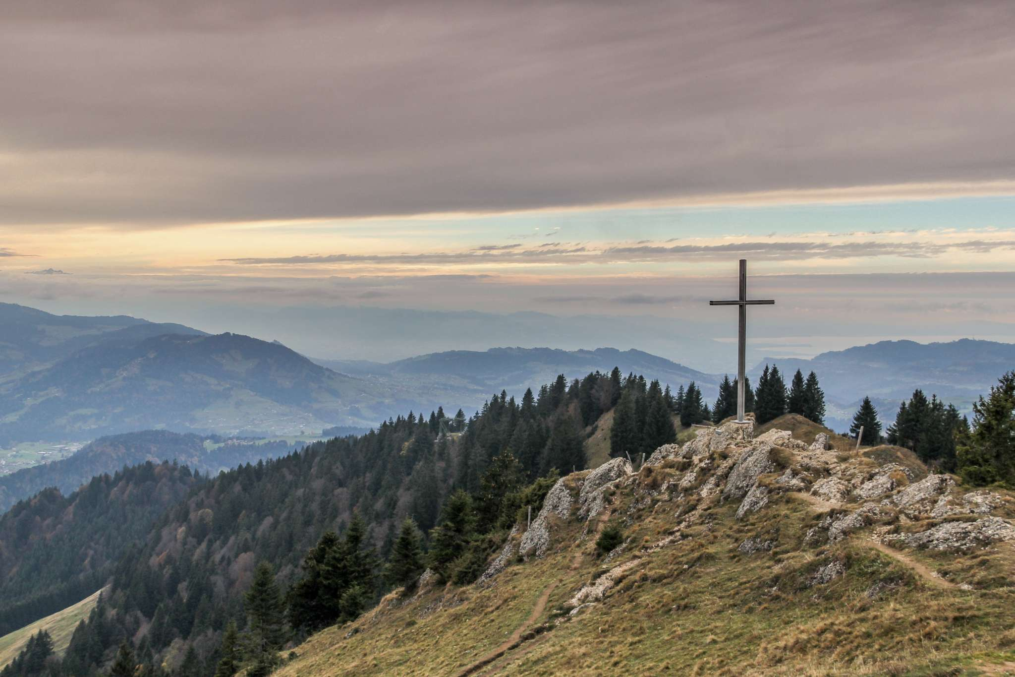 A cross planted atop a mountain
